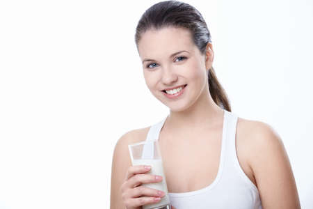 adults only: Attractive girl with a glass of milk on a white background Stock Photo