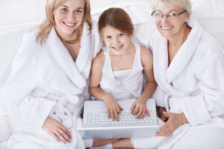 Three women of different ages with a laptop Stock Photo - 8645367