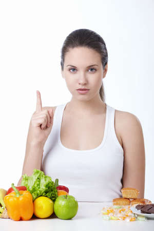 Attractive girl with a food isolated Stock Photo - 8645351