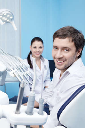 An attractive man at a reception at the dentist photo