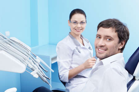 Doctor and patient in the dental clinic photo