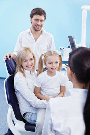 Young family with a child in the dental office photo