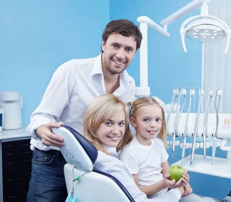 Smiling family in the dental office photo