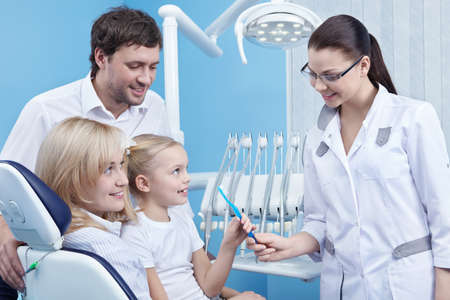 dental tools: Dentist gives the child a toothbrush in the dental office Stock Photo