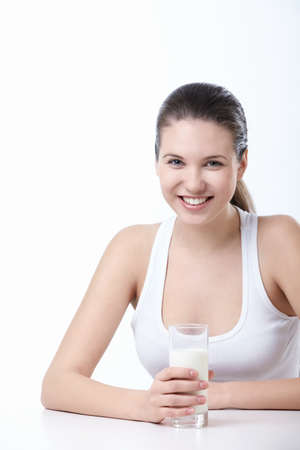 drinking milk: Attractive young girl with a glass of milk on a white background