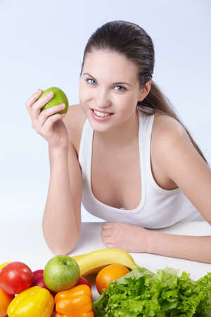 plenty: Attractive girl with fruits and vegetables on white background
