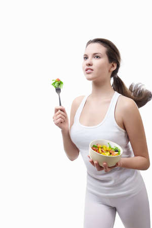 Beautiful girl running with a salad on a white background photo