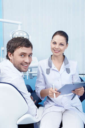 Patients and doctors in the dental office photo