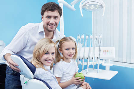 Families with a child in the dental office photo