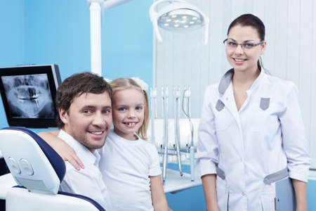 Family doctor in the dental office photo