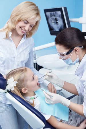 family practitioner: Child treated teeth in the dental clinic Stock Photo