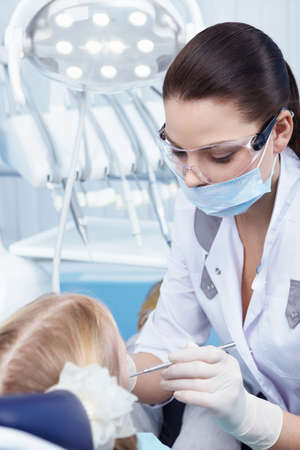Child treated teeth in the dental clinic Stock Photo - 8699761