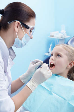 Children's doctor treats your child's teeth Stock Photo - 8699774