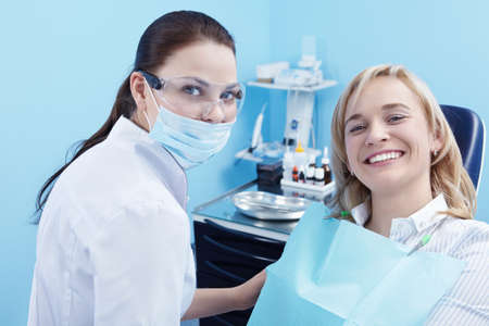 dentists clinic: The patient on examination by a doctor in a dental clinic Stock Photo