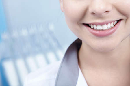 orthodontic: Beautiful young woman smiling closeup Stock Photo