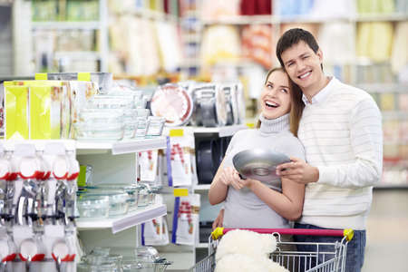 couple laughing: Attractive couple laughing in the store