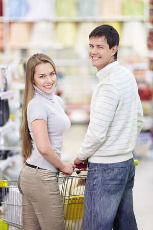 Attractive happy couple in the store photo