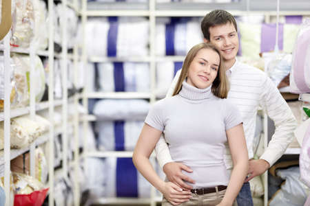 Embracing a married couple in the store Stock Photo - 8695466