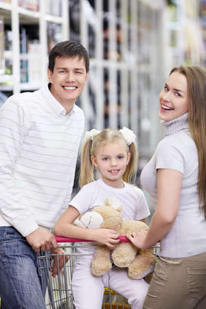 A happy family with a child in a store photo