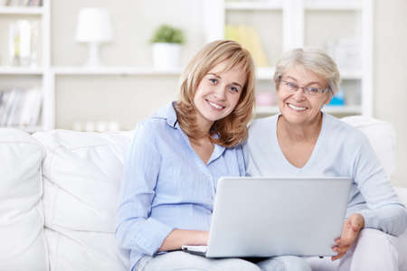 Families with a laptop on the couch Stock Photo - 8695836