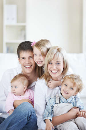 family living: Attractive family with three children at home Stock Photo