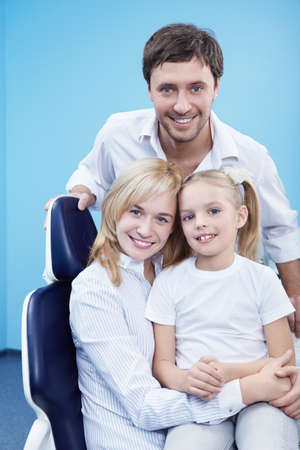 Young family with a child in dentistry photo