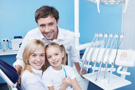 family medicine: Young family with a child in dentistry