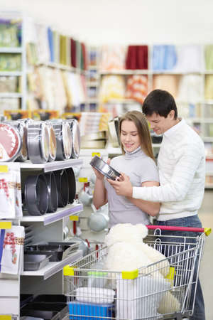 Young married couple in the store photo