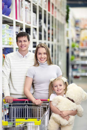 Families with a child makes a purchase in a store Stock Photo - 8695507