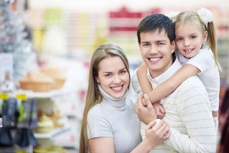 Portrait of a happy family in the store photo
