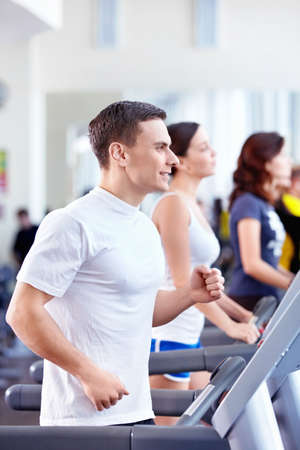 Attractive people on the treadmill Stock Photo - 8700133