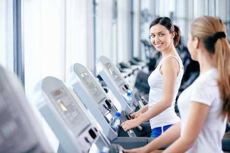 Young attractive girls in the gym Stock Photo