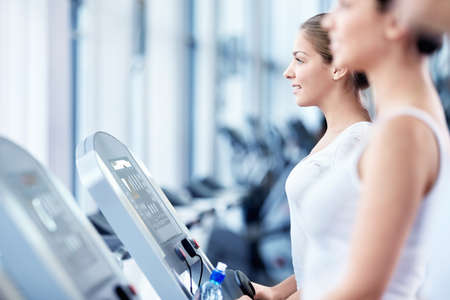 Girls involved in fitness on a treadmill photo