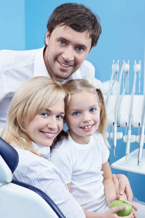 Young family at a reception at the dentist photo