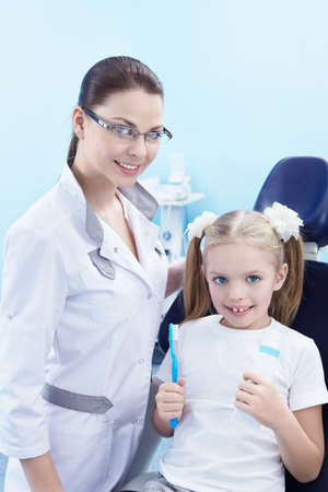 Dentist with a child in the dental clinic photo