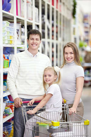 A young family is shopping in a store photo
