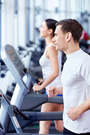 fitness club: Young attractive people in the fitness club Stock Photo