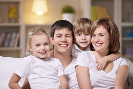 A happy family with children at home in the evening Stock Photo - 8800388