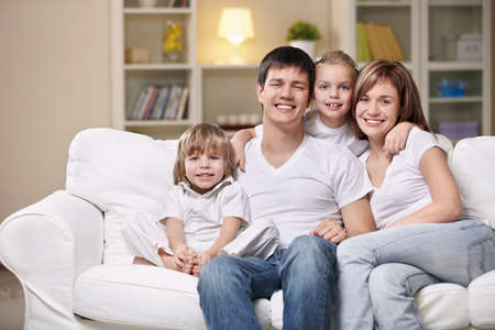 sitting room: Smiling family home evening Stock Photo