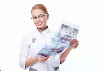 A young doctor with x-rays on a white background Stock Photo - 8961797