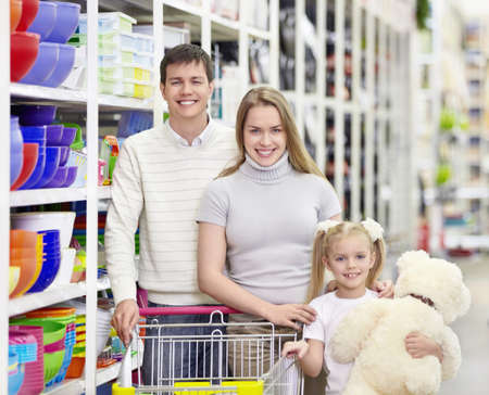 Young family with a child in a store photo