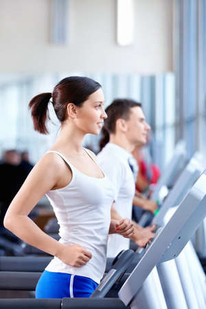 Attractive young people engaged in fitness Stock Photo - 8969649