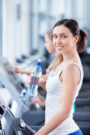 Young attractive girl in the fitness club photo