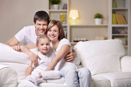 lifestyle home: A happy family with a child at home in the evening