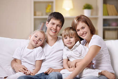A happy family with children at home in the evening photo