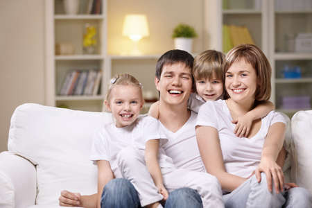 Attractive family with children at home in the evening Stock Photo - 8969657