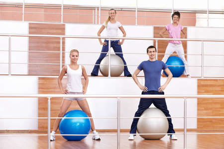 Attractive young people in fitness club Stock Photo - 8969163