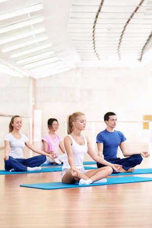 closed club: Young people practice yoga in the fitness club