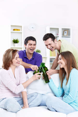 party room: Young friends drinking beer