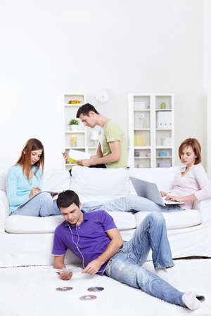 writing activity: Young people are engaged in a variety of activities Stock Photo